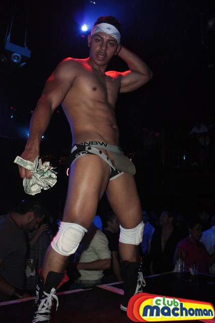sexy male stripper on stage of macho man club