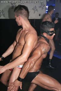 Two handsome malestripper on stage